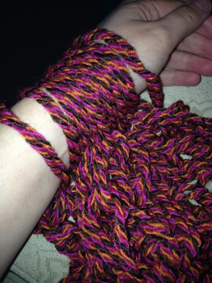Scarf underway - 12 stitches on my arm.