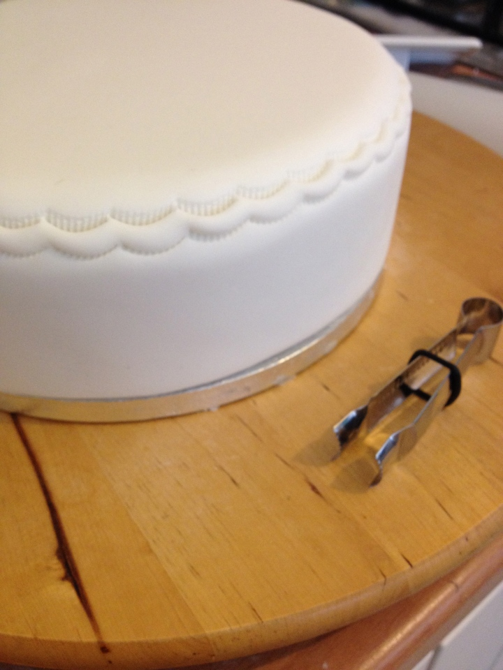 The top edge of the cake was crimped with this handy, little tool.