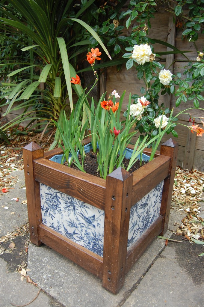 Flowers in the decoupaged planter