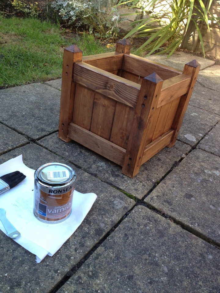 First coat of wood stain on the planter.