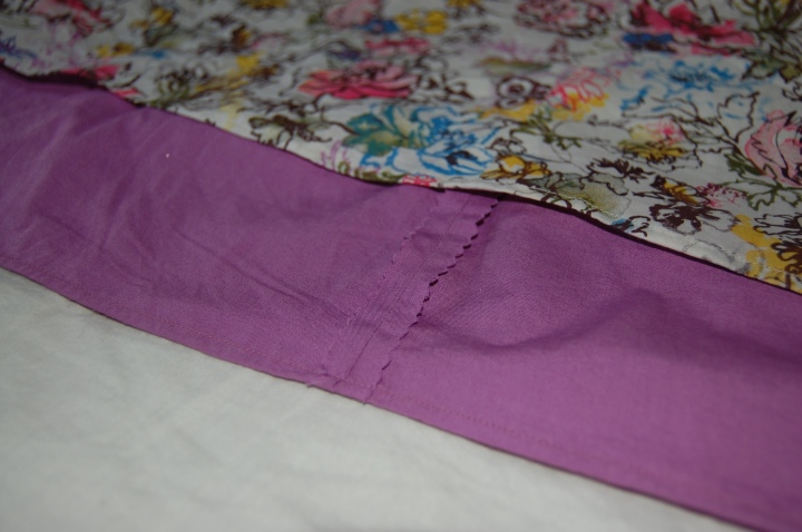 Exposed seam-age on the visible part of the decorative hem. I don't have an overlocker, so I just pink my seams to finish.