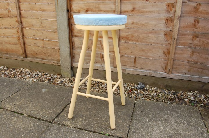 Use spray adhesive to glue the foam to the stool