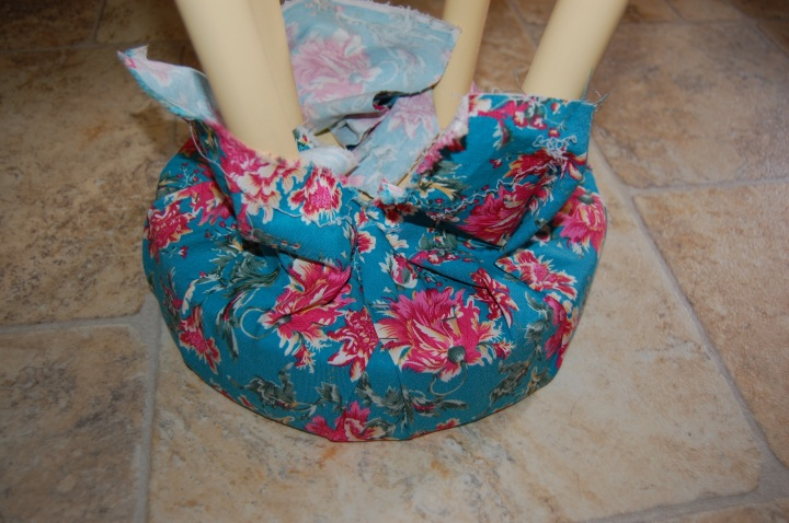 Staple decorative fabric to the stool in the same way as the batting