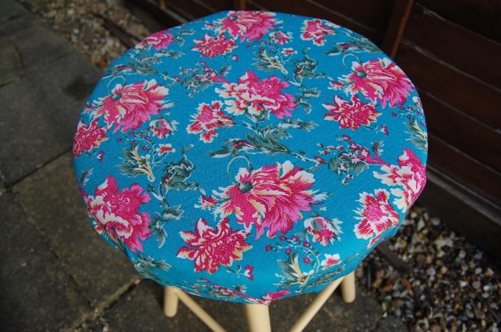 Hawaiian print upholstered stool