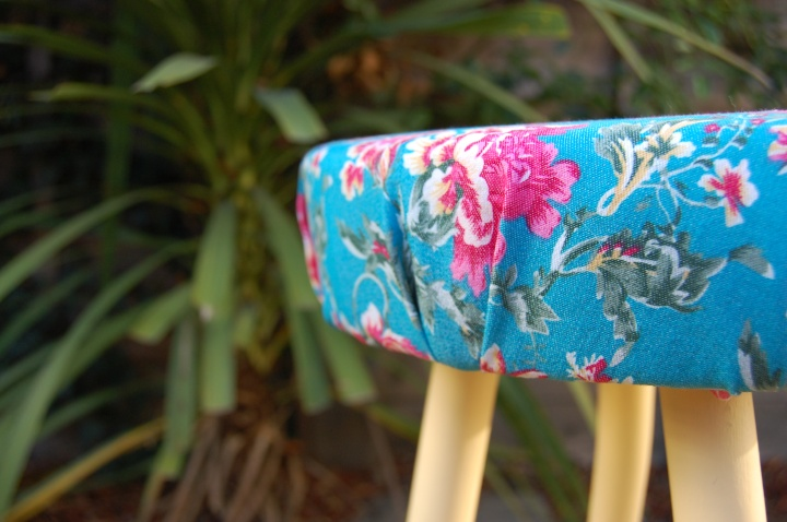 Hawaiian print upholstered stool
