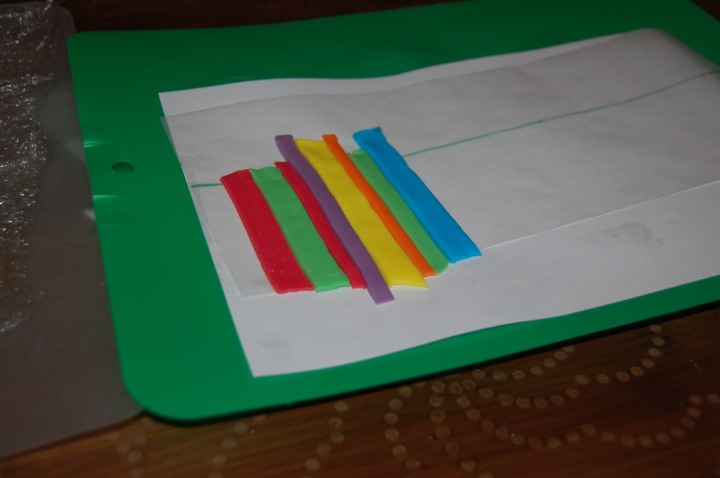 Line the stripes up side by side on a sheet of wax paper