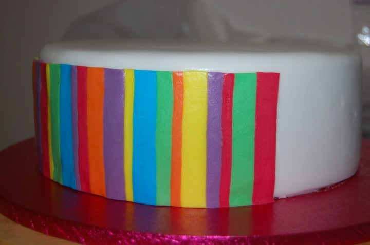 Rainbow striped icing on the cake