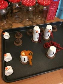 The snowmen under construction.